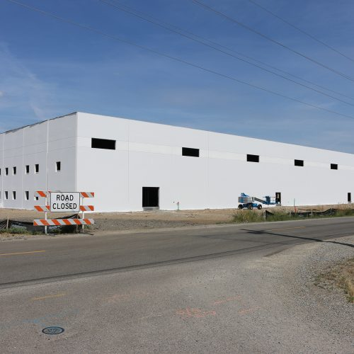 Large manufacturing warehouse that is being constructed on property