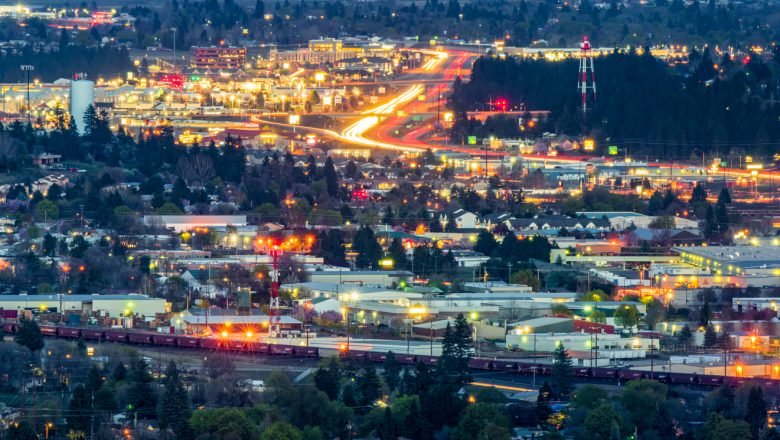 Night photo of trains, freeway